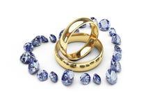 Anelli di cerimonia nuziale dell'oro nel cuore del diamante Fotografia Stock