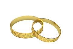Anelli di cerimonia nuziale dorata con il tracery magico Immagine Stock Libera da Diritti
