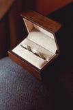 Anelli di cerimonia nuziale nella casella Fotografia Stock