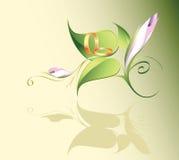 Anelli di cerimonia nuziale su un fiore Fotografia Stock