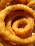 Anelli di cipolla dorati Fotografie Stock