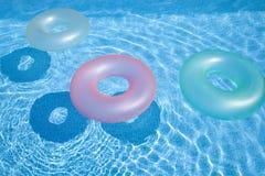 Anelli di nuoto in raggruppamento Fotografia Stock Libera da Diritti