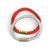Anelli lucidi rossi e d'argento dei capelli Fotografia Stock Libera da Diritti