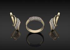 Anello di oro ed orecchini con i diamanti Fotografie Stock
