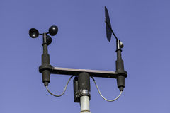 Anemometer in blue sky. Anemometer at weather station against blue sky Stock Image