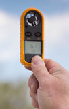 Anemometer in the hand of man,  wind speed 16.1 ms . Clouse-up Royalty Free Stock Images