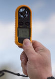 Anemometer in the hand of man,  wind speed 14.4 ms Stock Image