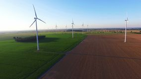 Anerial shot of wind turbines on field stock video footage