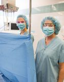 Anesthesiologist in Operating Suite. Anesthesiologist standing behind curtain in operating theater Stock Image