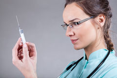 Anesthesiologist with a syringe. Female anesthesiologist holding a syringe before an injection Stock Photo
