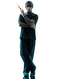 Anesthetist man holding surgery needle silhouette Stock Image