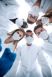 Anesthetists and surgeons working at the operation room stock photography