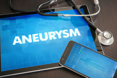 Aneurysm (heart disorder) diagnosis medical concept on tablet sc. Reen with stethoscope royalty free stock photography