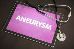 Aneurysm (neurological disorder) diagnosis medical concept. On tablet screen with stethoscope stock images