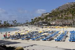 Anfi del Mar beach, Gran Canaria - Panoramic view on the sandy beach, Canary Islands. Anfi del Mar beach, Gran Canaria, Spain - March 14, 2019: people on the stock images