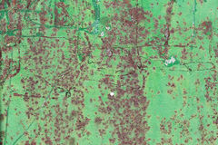 Anfrätt rostig grön metallbakgrund Fotografering för Bildbyråer
