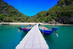 Ang Thong island,Thailand. Long-tailed boat moored on a tropical beach in a secluded cove on Ang Thong Island  in Thailand Stock Photography