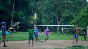 ANG THONG, THAILAND - 9 JUNE 2019: Thai teenagers playing sepak takraw in park. Group of men playing kick volleyball stock video footage