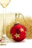 ange球香槟圣诞节玻璃最近的红色 免版税库存图片