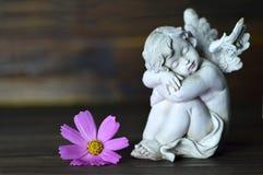 Ange et fleur rose Image stock
