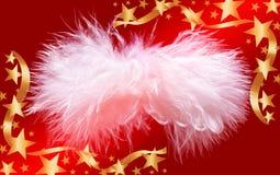 Ange pelucheux de Noël dans la trame d'or d'étoiles Images stock