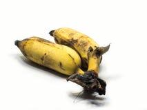Angebaute Banane auf dem weißen Hintergrund u. dem Abschneidenteil Lizenzfreies Stockfoto