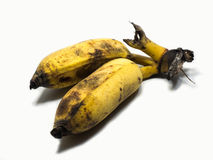 Angebaute Banane auf dem weißen Hintergrund u. dem Abschneidenteil Stockfoto