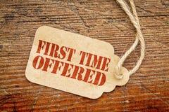 Angebotenes Papier-Preiszeichen des ersten Males Lizenzfreies Stockbild