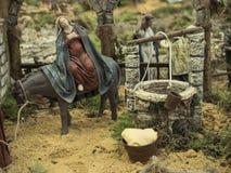 Angebracht am Esel durch den Brunnen Stockfotos