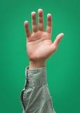 Angehobene männliche Hand lokalisiert Stockfotos
