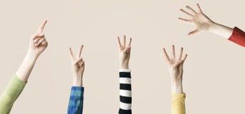 Angehobenes oben Hand- und Fingerdarstellen numerisch Stockbild
