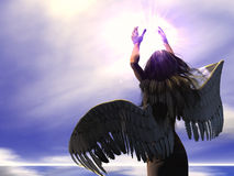 Angel - 01. An Angel of mercy holds a Divine light Stock Images