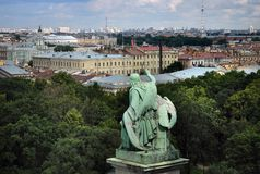 Angel. On a roof of the Isaakievsky cathedral soars over a city, looks at it from heavens and loves Stock Images