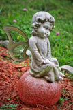 Angel. Baby angel statue on grave in cemetery stock photos