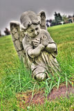 Angel. Praying angel statue holding cross on grave in old cemetery stock images