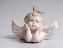 Angel. Porcelain figurine of an angel, the small romantic cupid from Raphael's picture Stock Image