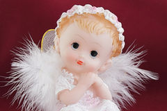 Angel. White angel in the guise of child against the dark background Royalty Free Stock Photography