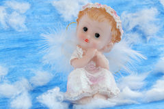 Angel. Sitting on the white clouds in the sky Stock Photos