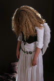 Angel. Curly hear girl with angel wings Royalty Free Stock Photos