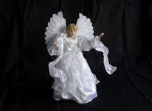 Angel. An angel figure on black background Stock Photos