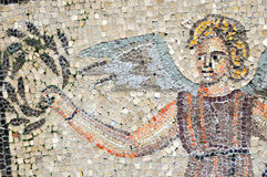 Angel. An angel offers a lawrel crown to a king. Part of the UNESCO listed mosaic floor of the basilica of Aquileia in Italy Stock Photography