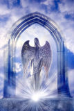 Angel. A beautiful angel archangel in heaven gate with rays of light Stock Photos