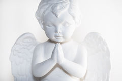 Angel. An angel on his knees praying Royalty Free Stock Photo