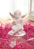 Angel. Smile angel statue with red decoration Royalty Free Stock Photography