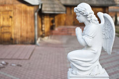 Angel. Stone sculpture angel praying in church Royalty Free Stock Images