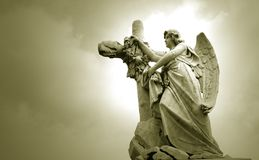 Angel. And cross in toned monochrome Stock Images