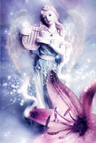 Angel. A beautiful angel with harp with lily flower Stock Photography