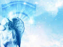 Angel. A statue of angel with dove over mystical gate Stock Photos
