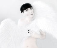 Angel. Women like an angel with white wings stock photo