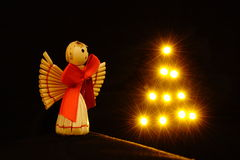 Angel. Little straw angel with shiny star tree Royalty Free Stock Photo